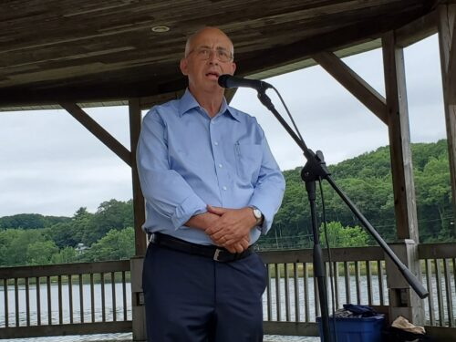 NDP Leader Gary Burrill speaks to protesters at Shipyards Landing, Bridgewater