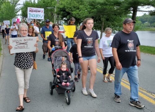 Tom Webber (far right) and family march from Mark Furey's office To Shipyards Landing