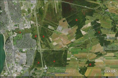 Une carte google map en vue satellite identifiée de chiffre de 1 à 8, montrant les endroits que la Vigile verte veut protéger pour former une forêt urbaine entre Brossard et La Prairie.