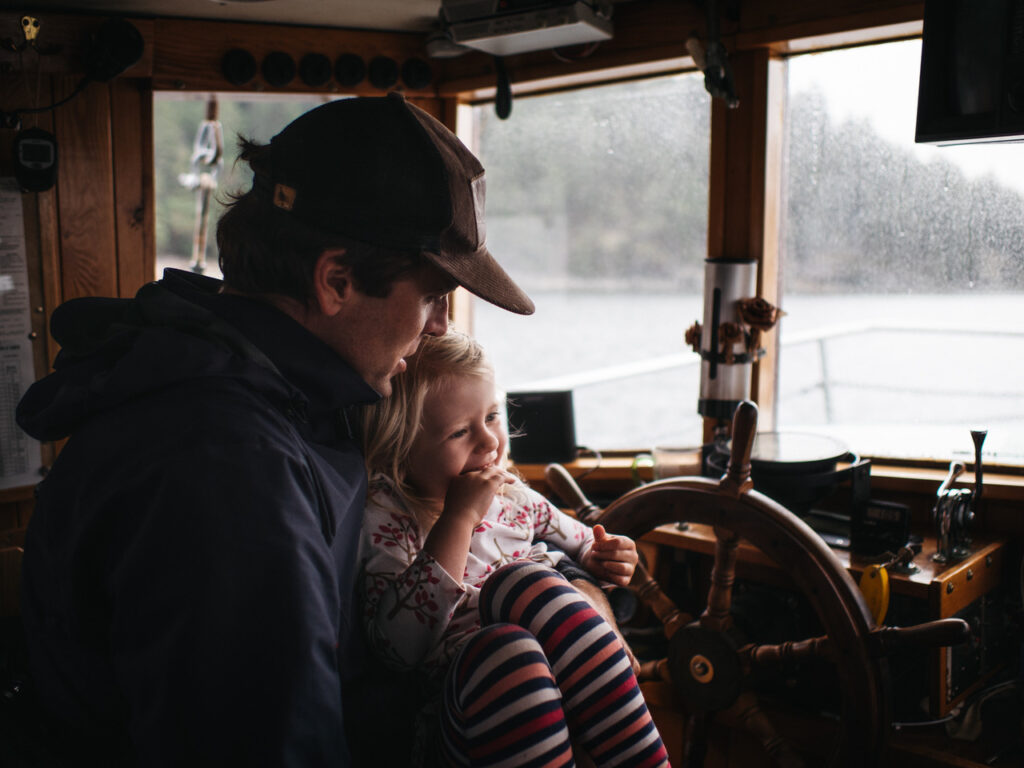 A photo of Jonas Fineman and his daughter on a boat.