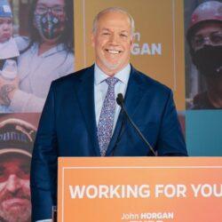 A photo of John Horgan at a press conference.
