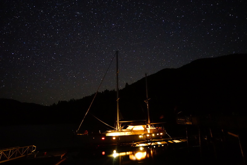 A photo of small ship beach clean up at night.