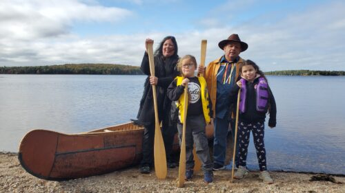 Labrador family members daughter Melissa, grandchildren Tepkunaset and Nakuset and Todd with canoe.