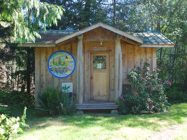 The entrance of the Friends of Cortes Island building in the woods.