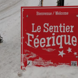 Red square sign at the beginning of the fairy trail. It reads Sentier Féerique.