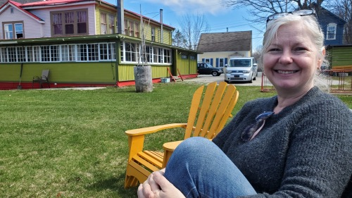 Annabelle Singleton relaxing behind the soon to be for sale, Port Grocer