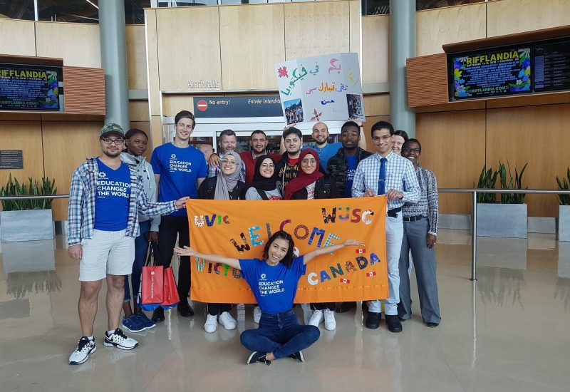 El-Musawi arriving in Victoria in 2018, greeted by the members of WUSC UVic.