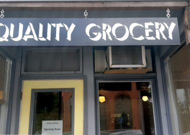 The exterior of a storefront with a sign that reads