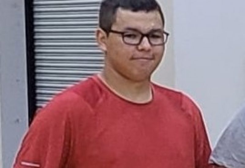 Young guys dressed in red shirt and wearing black rimmed glasses