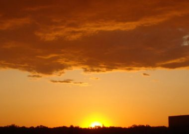 A picture of a yellow and orange sunset in a stock image by Flickr.