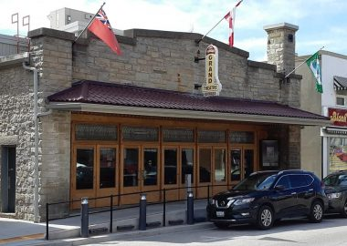 A cobblestone building known as the Fergus Grand Theatre sits downtown Fergus, Ontario.