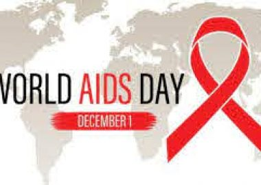A grey World AIDS Day graphic of a map of the world with a red ribbon on it.