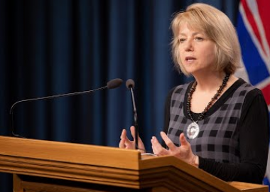 Dr. Bonnie Henry speaking at a podium during a press conference in B.C.