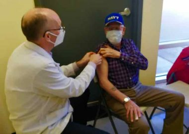 Pharmacist-owner Charles Beaver of Corner Drug finishes up giving a first COVID-19 shot to Sackville area resident Earl Thompson, Tuesday March 23, 2021. Photo: Erica Butler