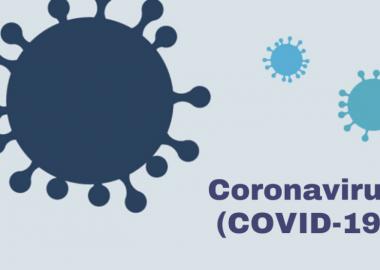 Blue cartoon virus' on a blue background reading coronavirus