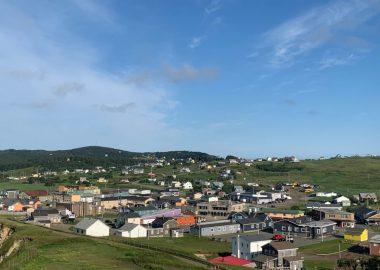 A photo of the village of Cap-aux-Meules in the Iles de la Madeleine, Quebec.