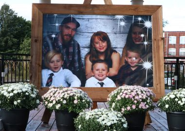 A photo of a family on display surrounded by flowers
