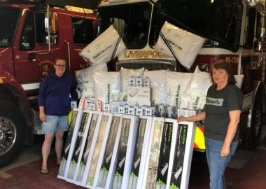 A photo of ladies auxiliary members with donations for Liverpool fire department.