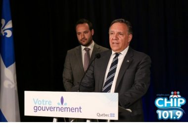 Photo of Francois Legault and Mathieu Lacombe during press conference in Chelsea, QC.