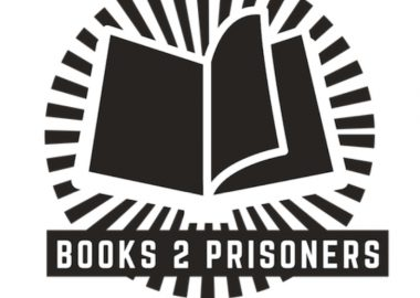 The black and white Books 2 Prisoners logo featuring a graphic of an open book