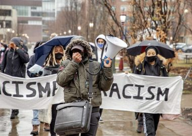 Organizers walking outside near the University of Ottawa prostesting the new anti-racism committee. Photo courtesy of @Uracism.e instagram page.