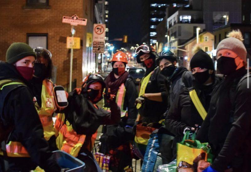 Ottawa Street Medics deliver food in downtown Ottawa at night.