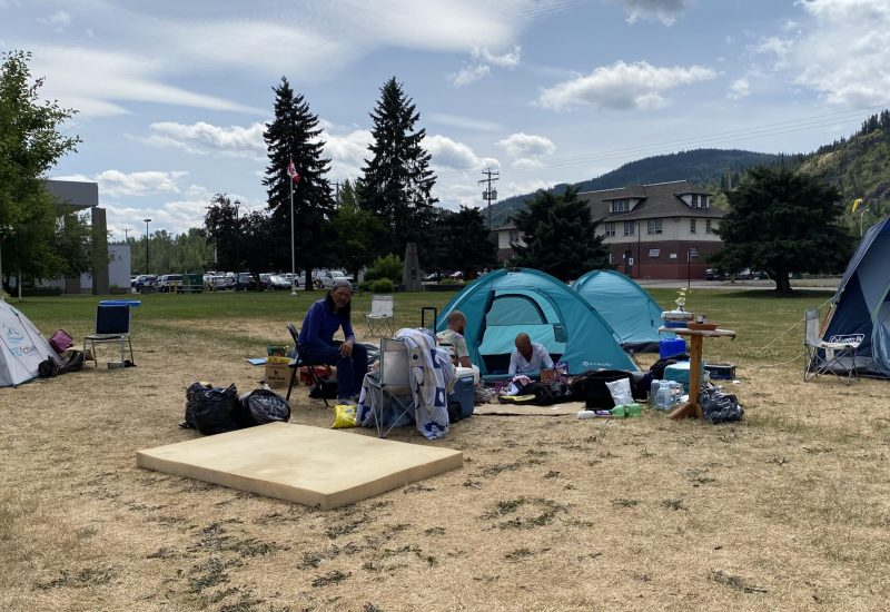 Tents are seen in a field in Smithers on a sunny day.