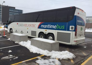 A Maritime Bus coach outside of a bus station.