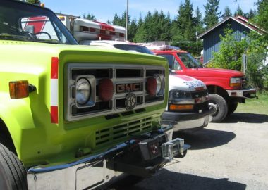 A photo of volunteer fire trucks and an ambulance (from Campbell River) at Cortes Island 2017 Emergency Preparedness & Awareness Weekend.