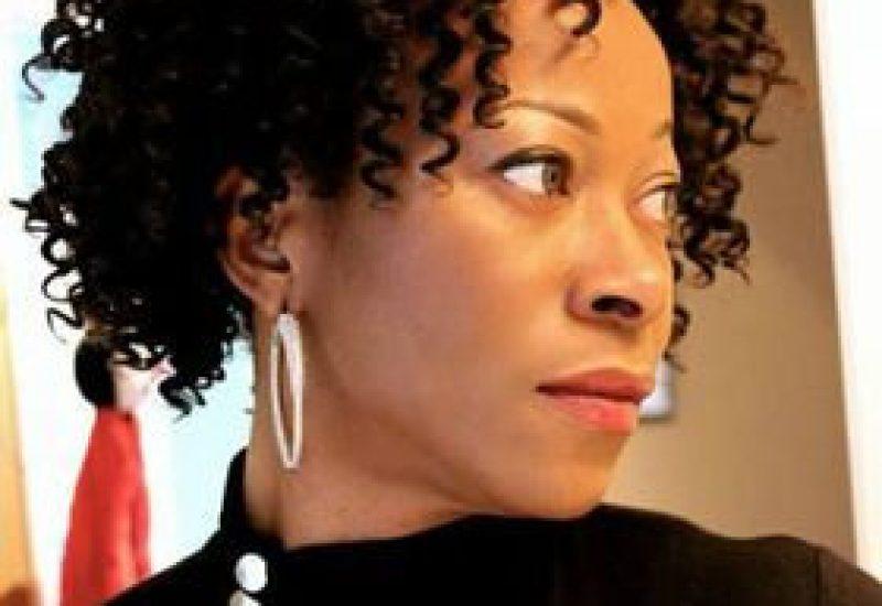 A profile headshot of Irene Ekweozoh
