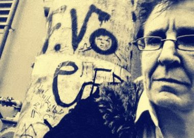 A close up of Karen Ward next to street art.