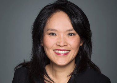 An official parliamentary headshot of Jenny Kwan against a grey backdrop