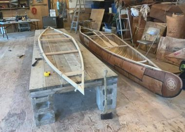 Traditional Mi'kmaq birch bark canoe being built