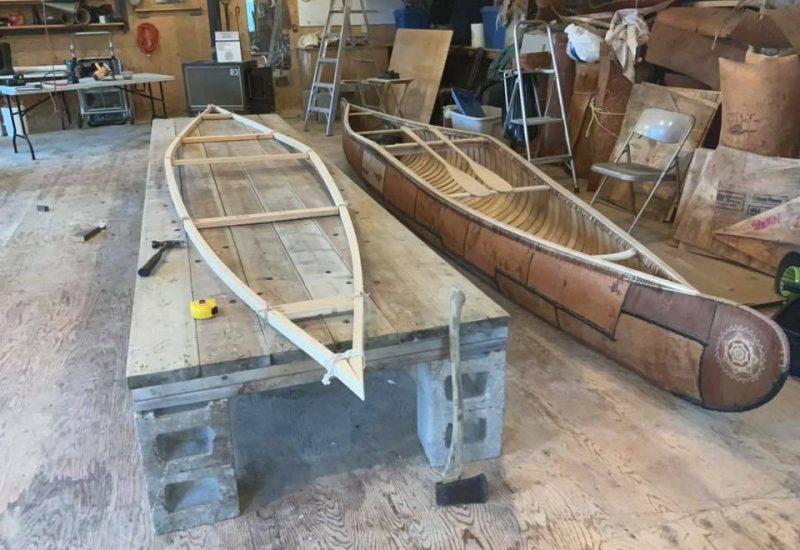 Traditional Mi'kmaq birch bark canoe being built