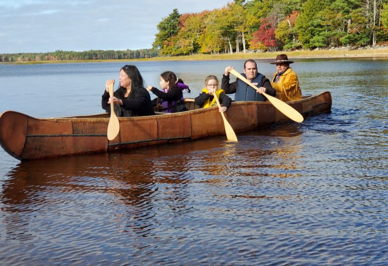 Three generations of the Labrador family paddle the newly finished canoe