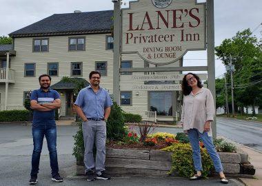 Manager Milan Virani, New Owner Ankur Viirani and Susan Lane stand outside Lane's Privateer Inn