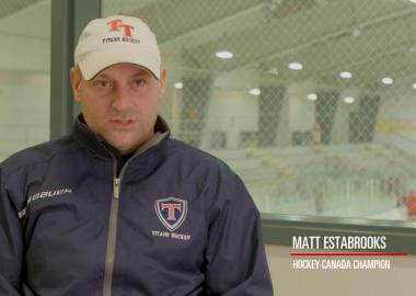 A still of Matt Estabrooks in a hockey rink.