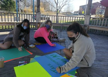 Molly Park, Michelle Roy, and Seena Katayama make posters in preparation for Thursdays solidarity protest over sexual assault handling at Mount Allison University. Photo: Erica Butler