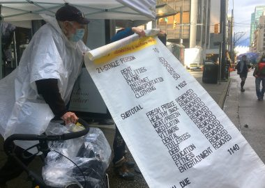 Giant novelty receipt showing expenses for people who depend on B.C. disability assistance