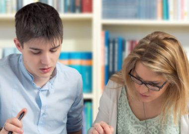 A student and teacher work at the Nanaimo-Ladysmith School District.