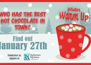 A poster for the Warm it up event, featuring a steamy cup of hot chocolate with marshmallows.