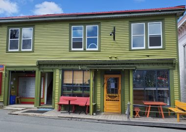 The green exterior of the Port Grocer in Port Medway on a sunny day