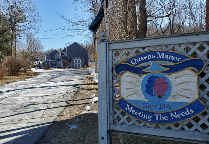Entrance sign at the end of the driveway to Queens Manor
