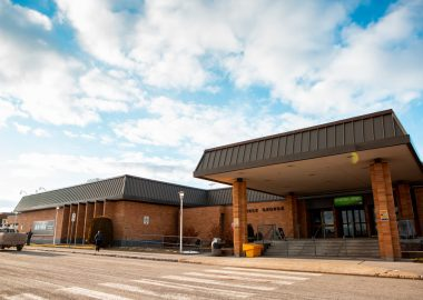 An image of the Prince George Airport on a sunny day, clouds in the sky.