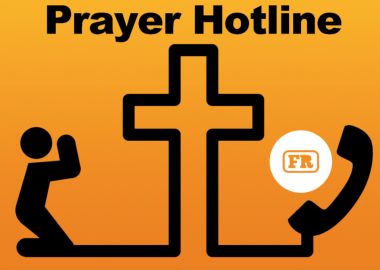 There is an orange background with the outline of a generic human a cross and a telephone. The title reads prayer hotline.
