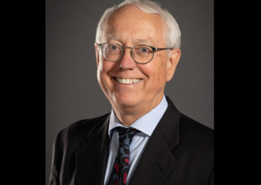 A headshot of Murray Rankin against a charcoal background