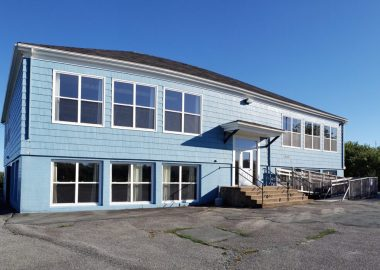 The outside of the blue Seaside Centre on a sunny day