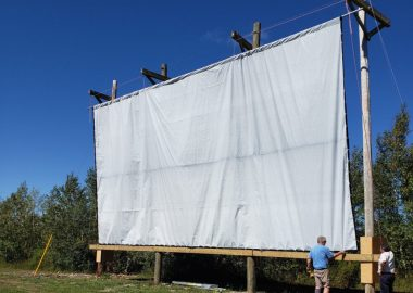 The South Shore Drive-in screen on a sunny day outdoors.