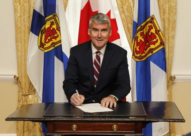 Premier Stephen McNeil signs minister's oath of office. Photo credit: Nova Scotia Government