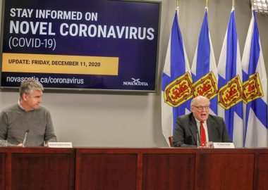 Premier Stephen McNeil speaking at a table at a COVID-19 press conference.